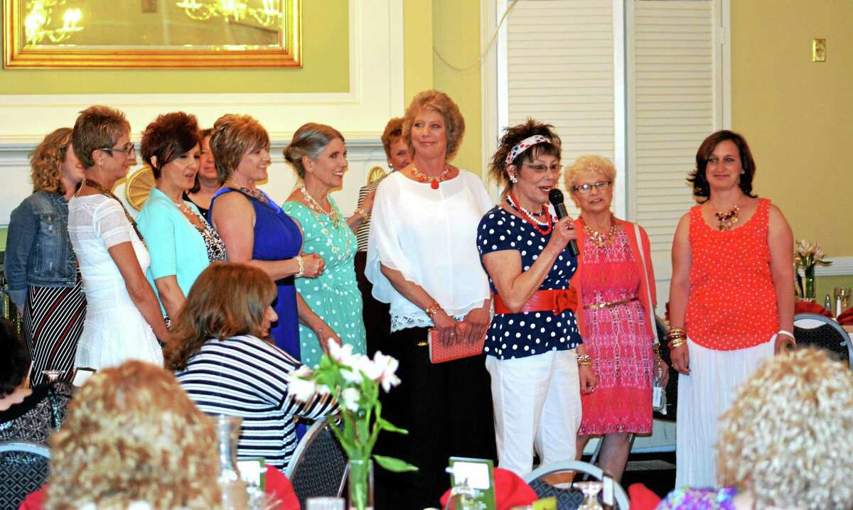 Pauline Maxwell, Dress Barn fashion stylist speaks to the crowd at the end of Sunday's Spring Fling Fashion Show in Torrington. Ryan Flynn - Register Citizen