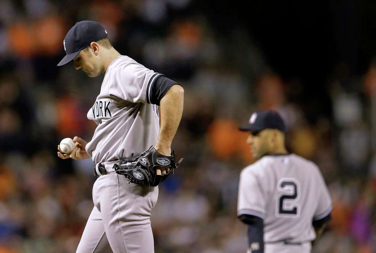 Yankees relief pitcher David Robertson pauses after the Orioles' Quintin Berry scored to tie the game in the ninth inning Sunday.