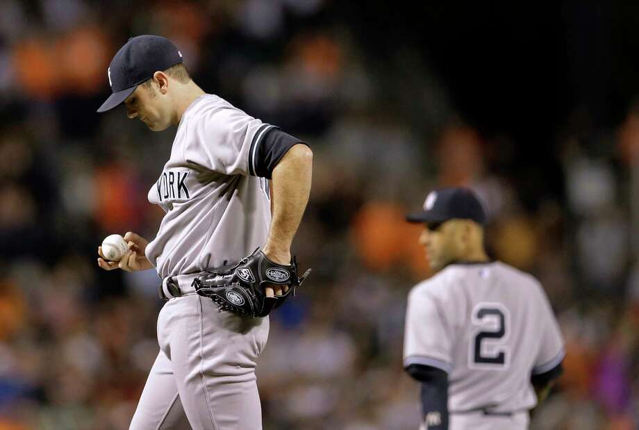 Yankees relief pitcher David Robertson pauses after the Orioles' Quintin Berry scored to tie the game in the ninth inning Sunday. Photo: Patrick Semansky — The Associated Press  / AP