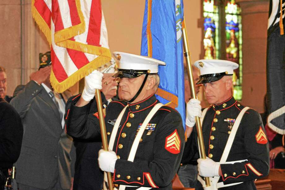 Multiple veteran groups were represented Sunday. Here, under the command of Sgt. Glenn Davis, Marine Corps League #42 Honor Guard from Canaan presents the nation's colors. Photo: Journal Register Co.