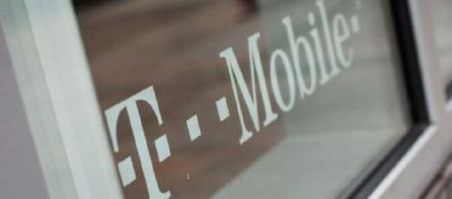 A T-Mobile store is seen at 7th Avenue and 49th Street on March 23, 2012 in New York City.