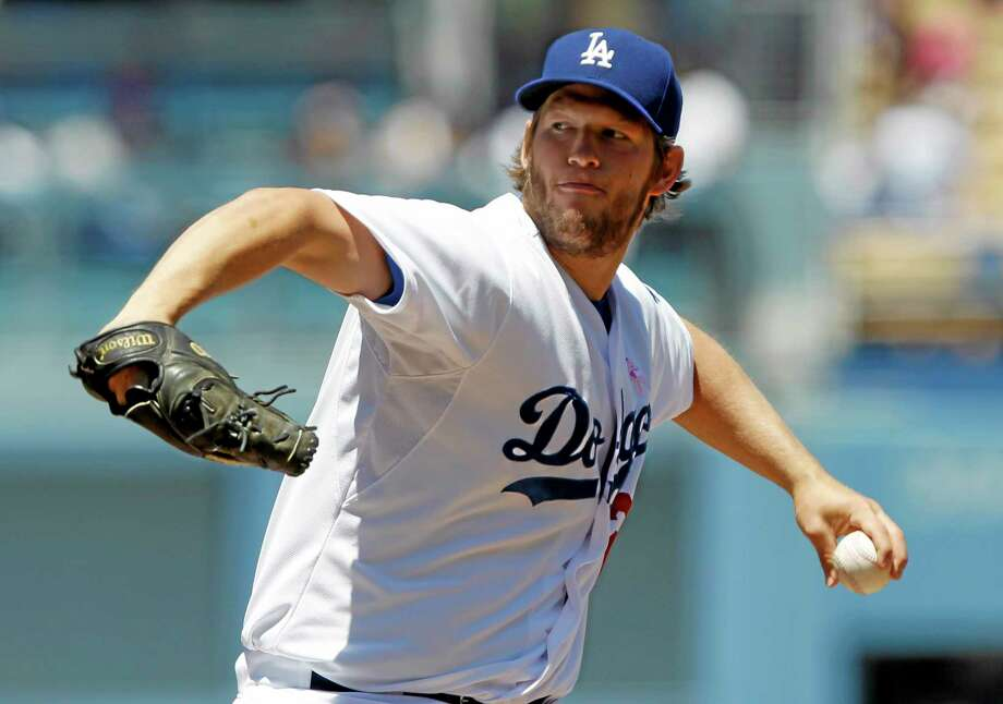 Dodgers starter Clayton Kershaw throws against the San Francisco Giants on Sunday in Los Angeles. Kershaw is your No. 1 fantasy baseball starting pitcher for the next 10 years. Photo: Alex Gallardo — The Associated Press  / FR170211 AP