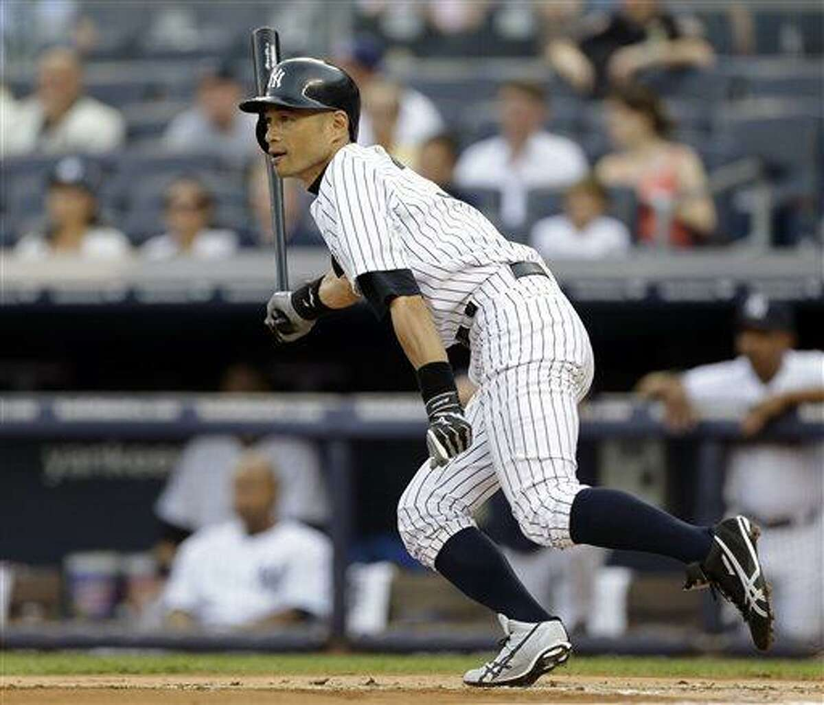 New York Yankees' Ichiro Suzuki follows through on a base hit off Texas Rangers starting pitcher Yu Darvish in the first inning of a baseball game Tuesday, June 25, 2013, in New York. (AP Photo/Kathy Willens)