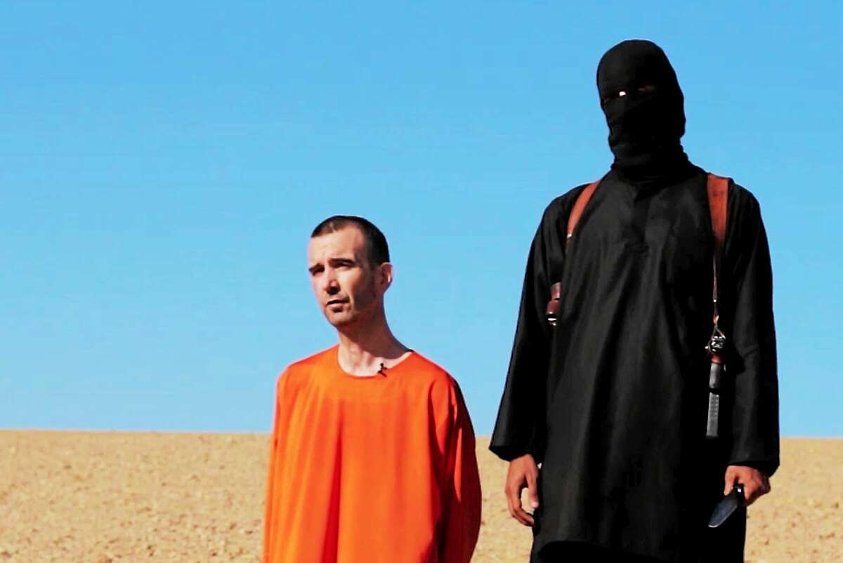This image made from video posted on the Internet by Islamic State militants and provided by the SITE Intelligence Group, a U.S. terrorism watchdog, on Sept. 13, 2014, purports to show British aid worker David Haines before he was beheaded. The video emerged hours after the family of Haines issued a public plea on Saturday urging his captors to contact them. The 44-year-old Haines was abducted in Syria in 2013 while working for an international aid agency.