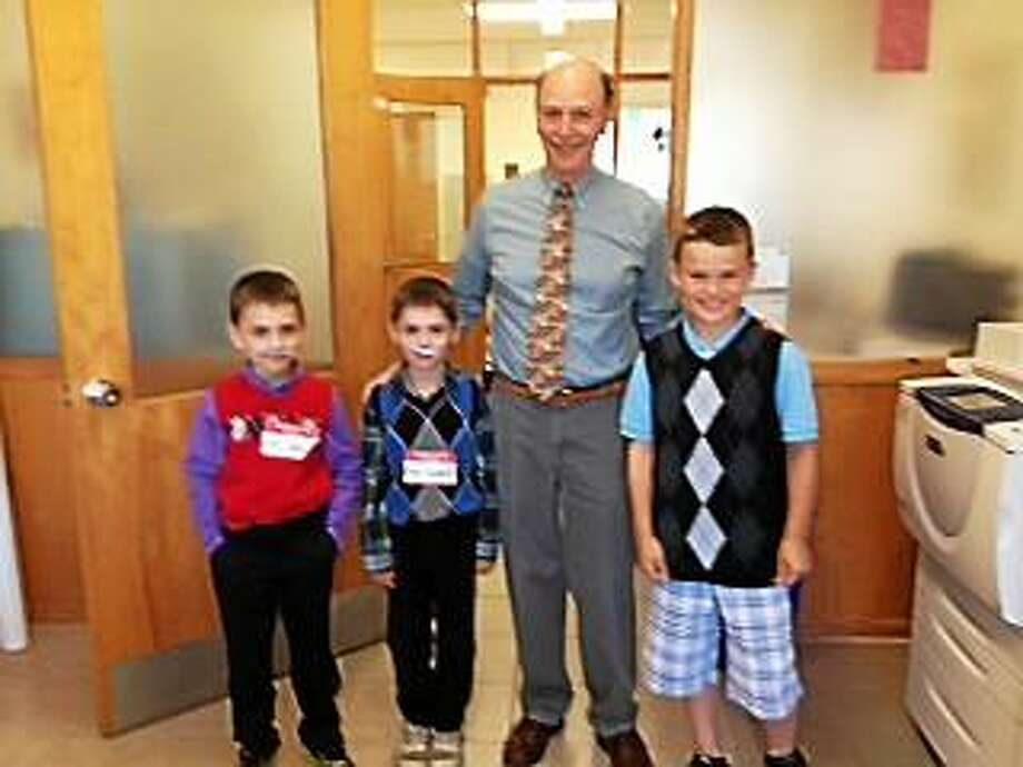 """Contributed Photo - Children dressed up in sweater vests, ties and fake mustaches last Wednesday to surprise their principal with """"Dress Like Mr. Weik day."""""""