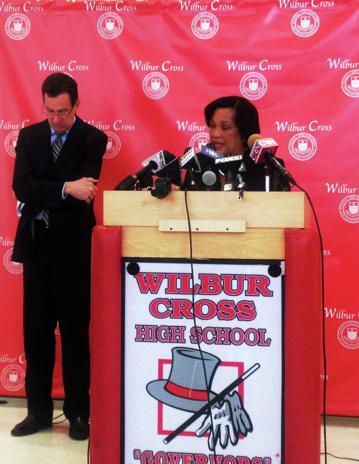 (Rachel Chinapen- New Haven Register) New Haven Mayor Toni Harp speaks at Wilbur Cross High School. Gov. Dannel Malloy is at left.