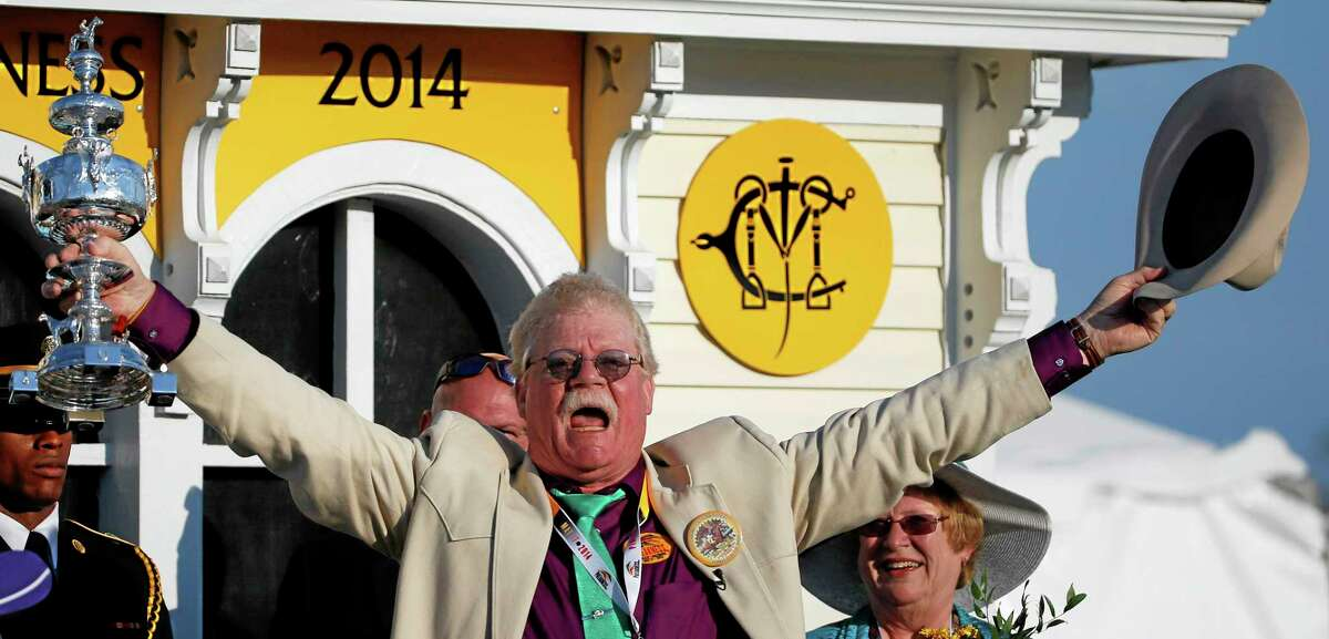 Co-owner Steven Coburn celebrates in the winner's circle.