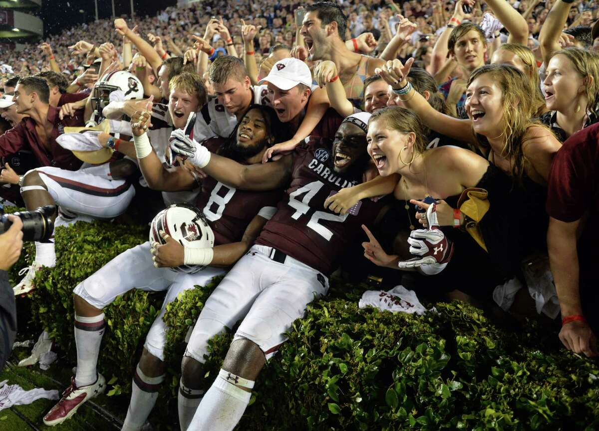 South Carolina players and fans celebrate their 38-35 win over Georgia ion Saturday.