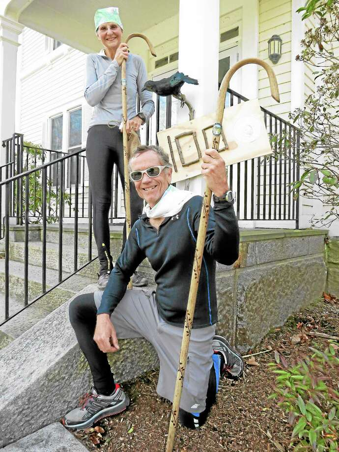 Contributed PhotoArt and Carol Morenz of Thomaston, CT finished the race a full 12 minutes before the closed competitor and received walking sticks as a prize. Photo: Journal Register Co.