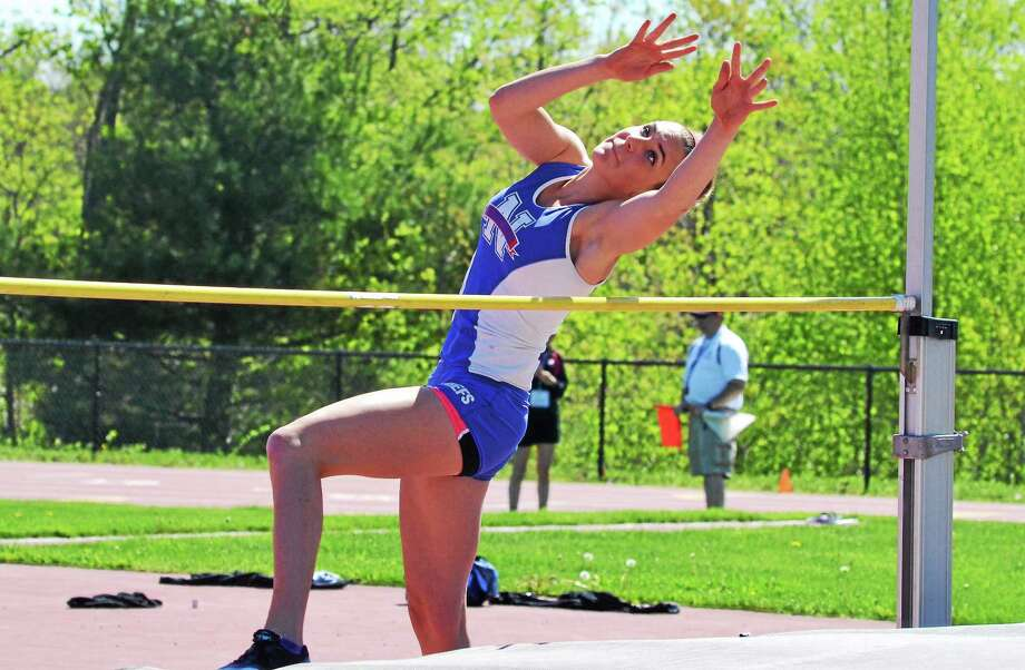 Nonnewaug's Mae Matthews won the high jump with a height out 4-feet 10 to help lead the Chiefs to their 19th straight girls Berkshire League title. Photo: Pete Paguaga — Register Citizen