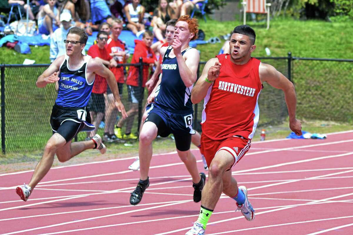 Northwestern's Tony Ortiz runs during his 200 meter dash win, helping lead Northwestern to the boys Berkshire League title for the first time since 2007. Ortiz also won the 400 meter dash.