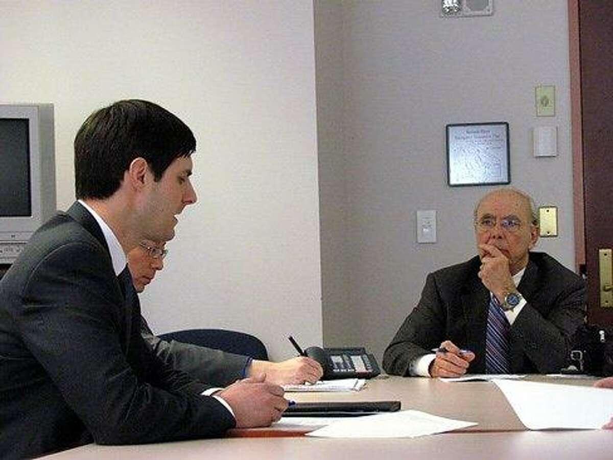 Justin Bernier pitches the pay reduction to Richard Balducci, center. Christine Stuart photo