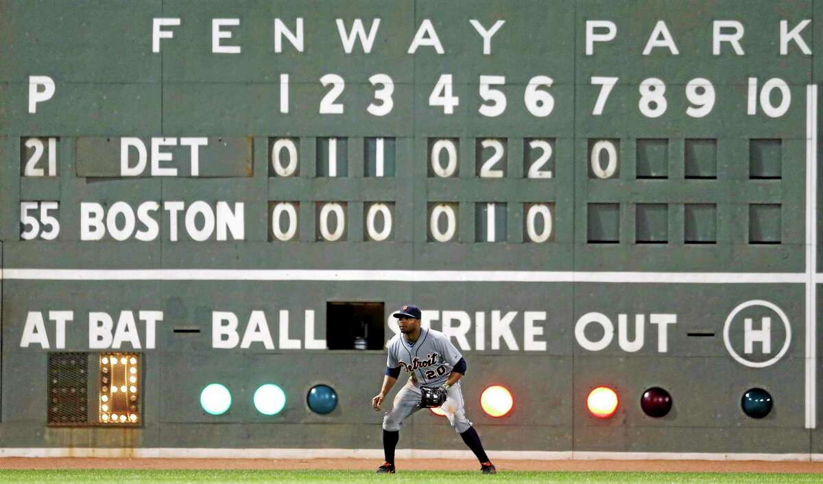 The scoreboard at Fenway Park shows the Tigers leading the Red Sox 6-1 in the seventh inning on Saturday.
