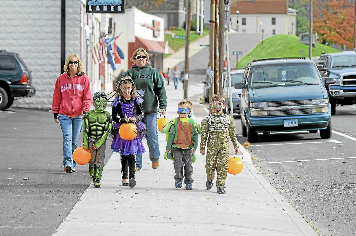 Jacob Joseph, Grace Joseph (Batterina), Anthony Corrado, A.J. Corrado followed by Moms Jennifer Joseph and Tanya Corrado in Winsted on Saturday for the city's annual trick-or-treat on Main St, hosted by Friends of Main Street.Laurie Gaboardi - Register Citizen