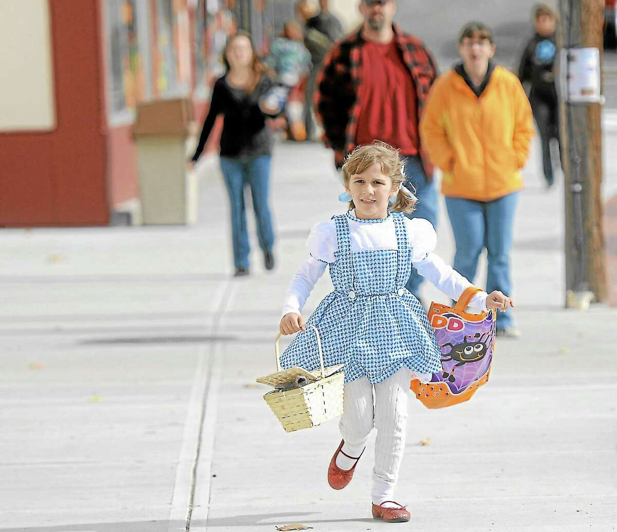 Mya Johnson, 6, looks for more trick-or-treat stops in Winsted on Saturday for the city's annual trick-or-treat on Main St, hosted by Friends of Main Street.Laurie Gaboardi - Register Citizen