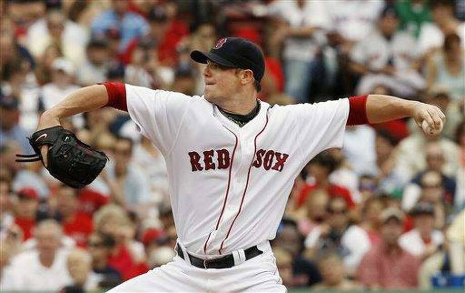 Boston Red Sox's John Lester pitches against the St. Louis Cardinals in a baseball game at Fenway Park in Boston, Sunday, June 22, 2008. (AP Photo/Winslow Townson) Photo: ASSOCIATED PRESS / AP2008