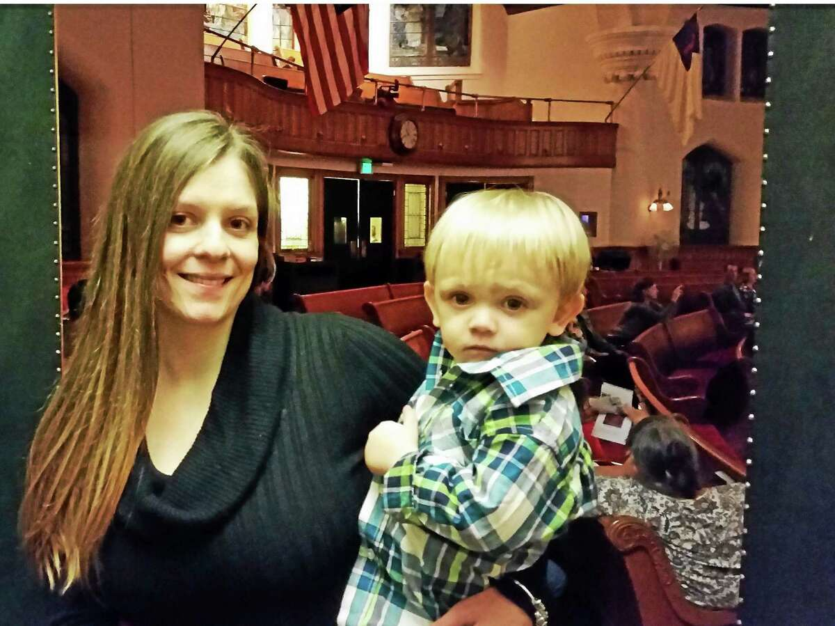 Amanda Fortier, 26, of Torrington, with son Logan, 18 months, attends The Steam Vent Coffee House monthly open mic event at First Church of Winsted, 95 North Main Street, which benefited her daughter Zoe Rose's cause.
