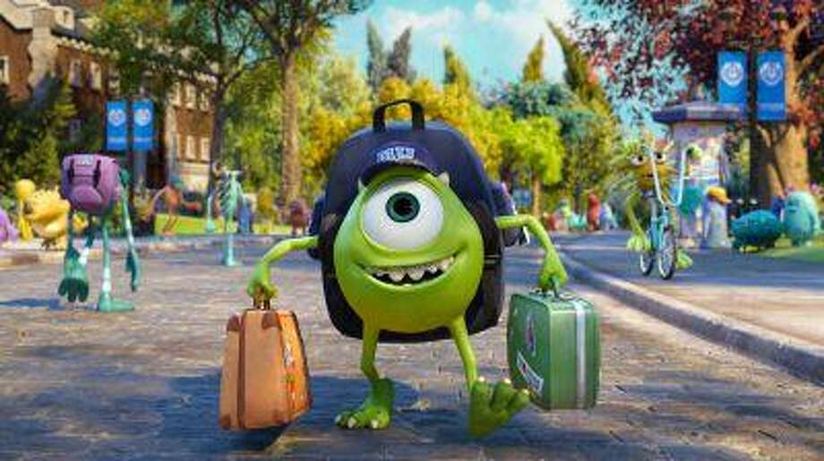 """This film publicity image released by Disney-Pixar shows Mike Wazowski, voiced by Billy Crystal in a scene from """"Monsters University."""" (AP Photo/Disney-Pixar) Photo: AP / Disney-Pixar"""