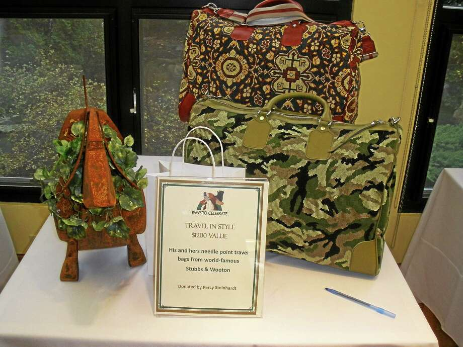 Stephen Underwood/Register Citizen Gifts were available for bidding at the Paws to Celebrate benefit for the Little Guild of St. Francis at the Litchfield Community Center. Photo: Journal Register Co.