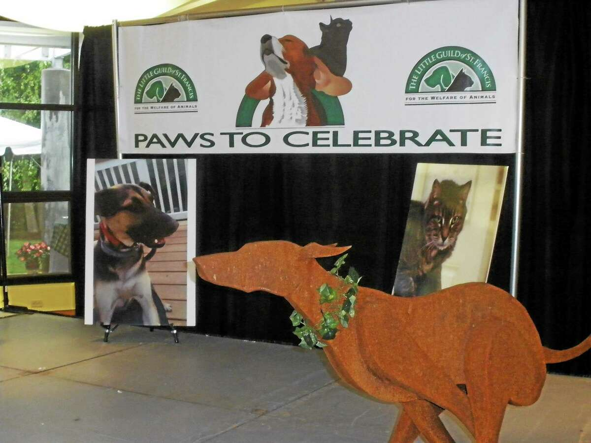 Stephen Underwood/Register Citizen A banner welcomes guests to the Paws to Celebrate benefit at the Litchfield Community Center Sunday.