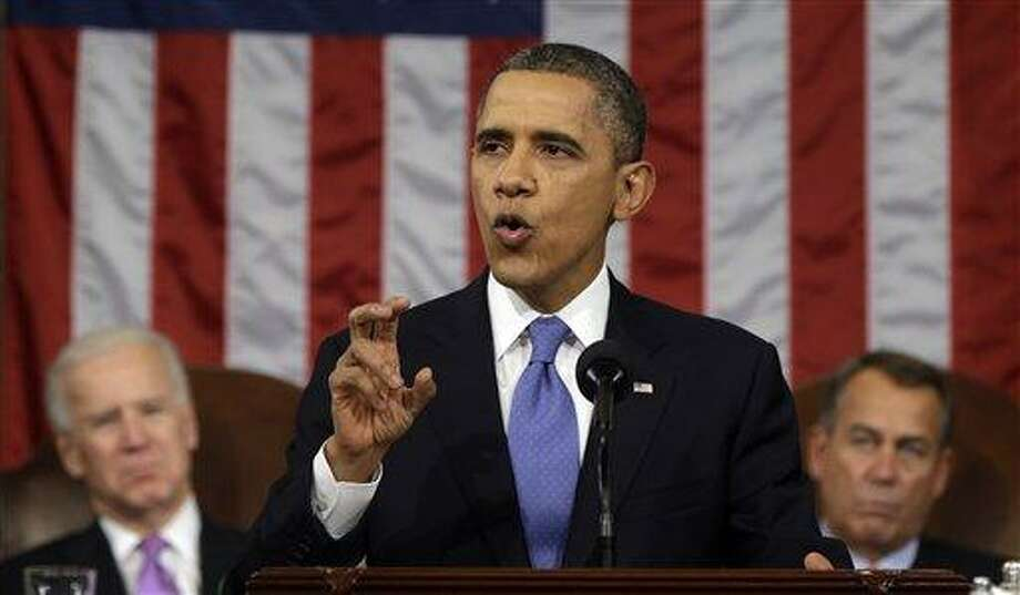President Barack Obama, flanked by Vice President Joe Biden and House Speaker John Boehner of Ohio, gestures as he gives his State of the Union address during a joint session of Congress on Capitol Hill in Washington, Tuesday Feb. 12, 2013. (AP Photo/Charles Dharapak, Pool) Photo: AP / AP Pool
