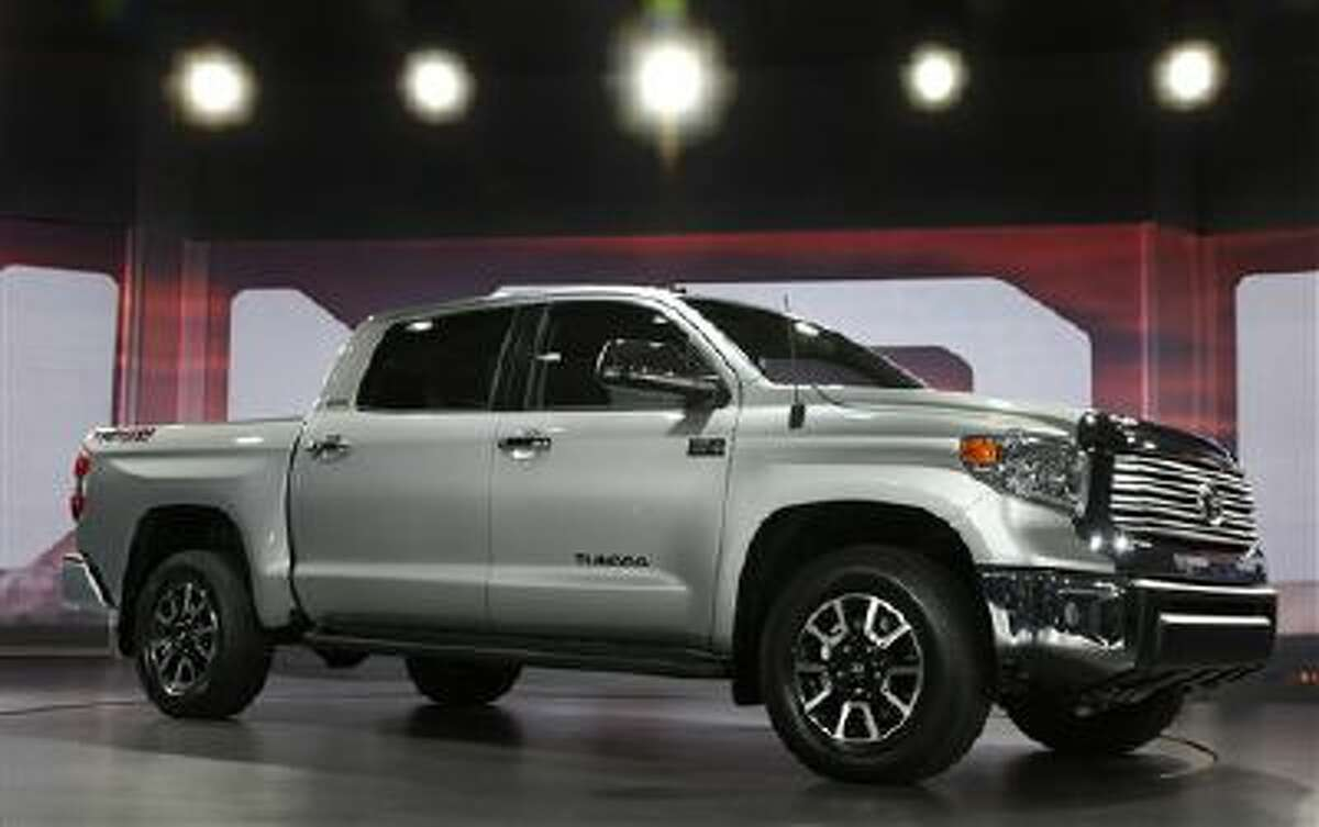 The redesigned 2014 Toyota Tundra is unveiled at the Chicago Auto Show, 2013, in Chicago. In its first major update since 2007, the full-size Toyota Tundra pickup truck is redesigned with a bold, American-style exterior, a refined, quieter interior and standard backup camera and Bluetooth phone and audio connectivity.