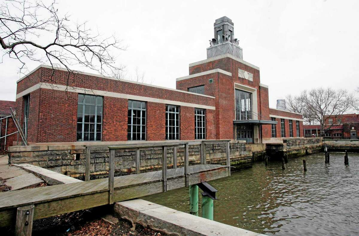 This March 26, 2007 file photo shows the ferry building on Ellis Island, N.J. The National Parks Service says the Ellis Island Immigration Museum will reopen to the public on Monday, Oct. 28, 2013. It's been about a year since Superstorm Sandy brought water levels as high as 8 feet to the iconic former U.S. immigration entry point.