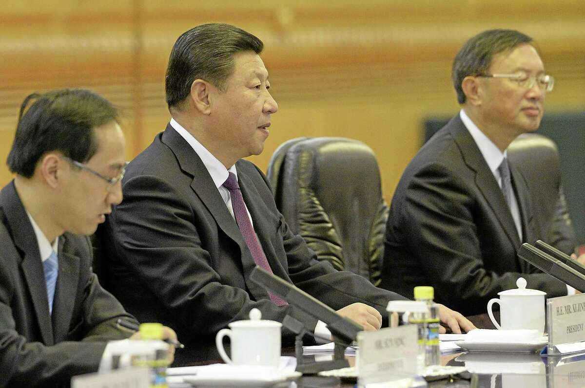 Chinese President Xi Jinping, second from left, talks with Australia's Governor-General Quentin Bryce during a meeting at the Great Hall of the People in Beijing, Thursday, Oct. 17, 2013. (AP Photo/Kota Endo, Pool)