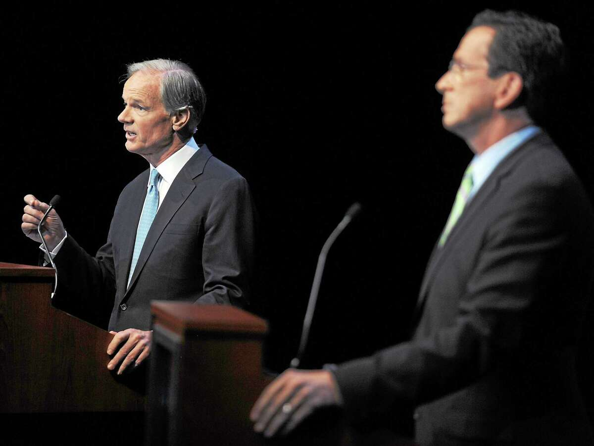 Republican Tom Foley, left, faces Democrat Dan Malloy in a gubernatorial debate held at the Garde Arts Center in New London, Conn., Wednesday, Oct. 13, 2010. (AP Photo/Tim Martin, Pool)