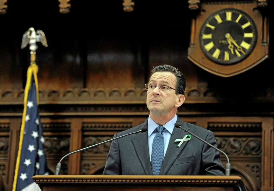 Connecticut Gov. Dannel P. Malloy addresses the House of Representatives and Senate during a memorial service for the victims of the Sandy Hook Elementary School shooting before a special session at the state Capitol in Hartford, Conn., Wednesday, Dec. 19, 2012. A gunman opened fire killing 26 people, including the principal and 20 children, at the school in Newtown before killing himself on Dec. 14. (AP Photo/Jessica Hill) Photo: AP / FR125654 AP