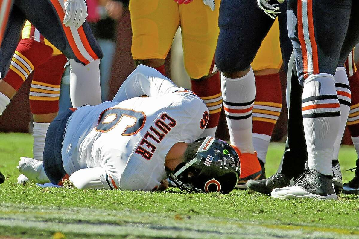 Chicago Bears quarterback Jay Cutler lies on the field after being injured during Sunday's game against the Washington Redskins in Landover, Md.