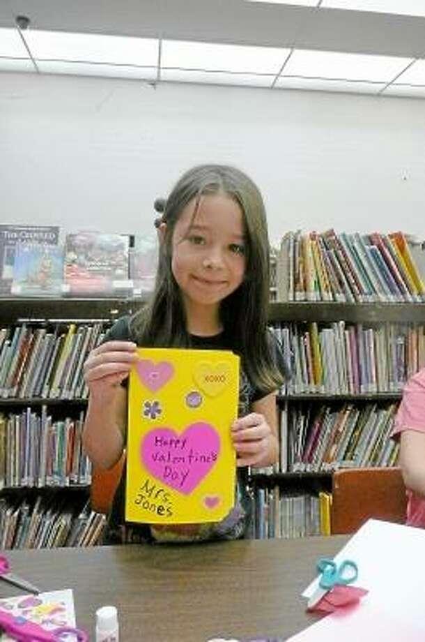 KATE HARTMAN/Register Citizen Liana Haxo, age 8, made a card for a teacher in her school.