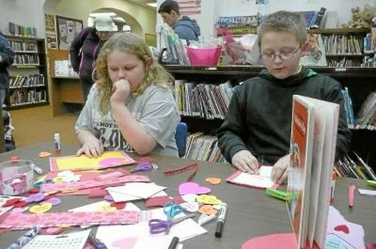 KATE HARTMAN/Register Citizen Local children spent part of their evening at the Torrington Library Wednesday, making cards for parents, friends and teachers.