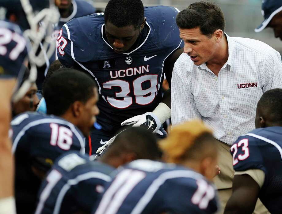 UConn coach Bob Diaco, right, talks to his team during the second half of Saturday's game against Boise State at Rentschler Field. Photo: Jessica Hill — The Associated Press  / FR125654 AP