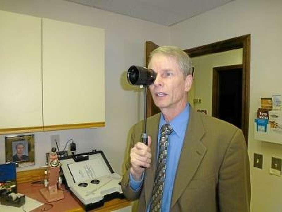 RYAN FLYNN/Register Citizen Dr. Randolph Kinkade is offering an implant for older people suffering from macular degeneration.