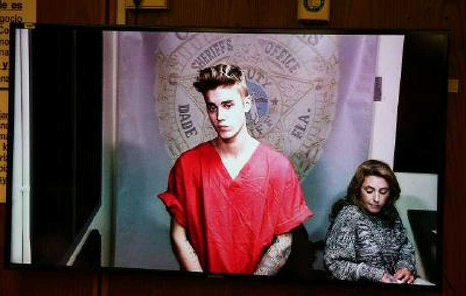 Justin Bieber appears in court via video feed, Thursday, Jan. 23, 2014, in Miami. Bieber was released from jail Thursday following his arrest on charges of driving under the influence, driving with an expired license and resisting arrest. Police say they stopped the 19-year-old pop star while he was drag-racing down a Miami Beach street before dawn.