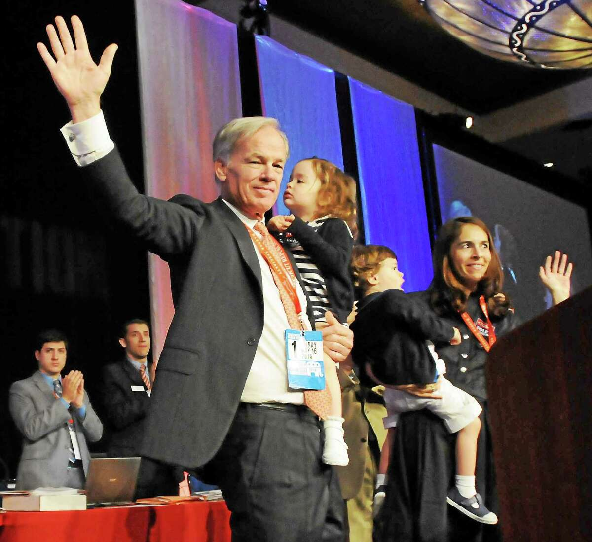 Tom Foley gets the Republican nomination for governor, as he waves holding his daughter Grace during the 2014 Connecticut Republican State Convention at the Mohegan Sun Convention Center in Uncasville Friday. On the right, his wife Leslie holds their son Reed.