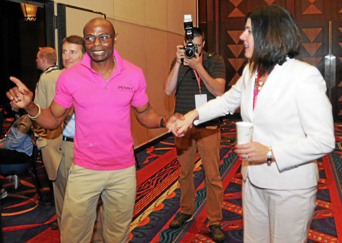 Penny Bacchiochi with her husband Emil Igwenagu after she was nominated for lieutenant governor during the 2014 Connecticut Republican State Convention at the Mohegan Sun Convention Center in Uncasville Friday.