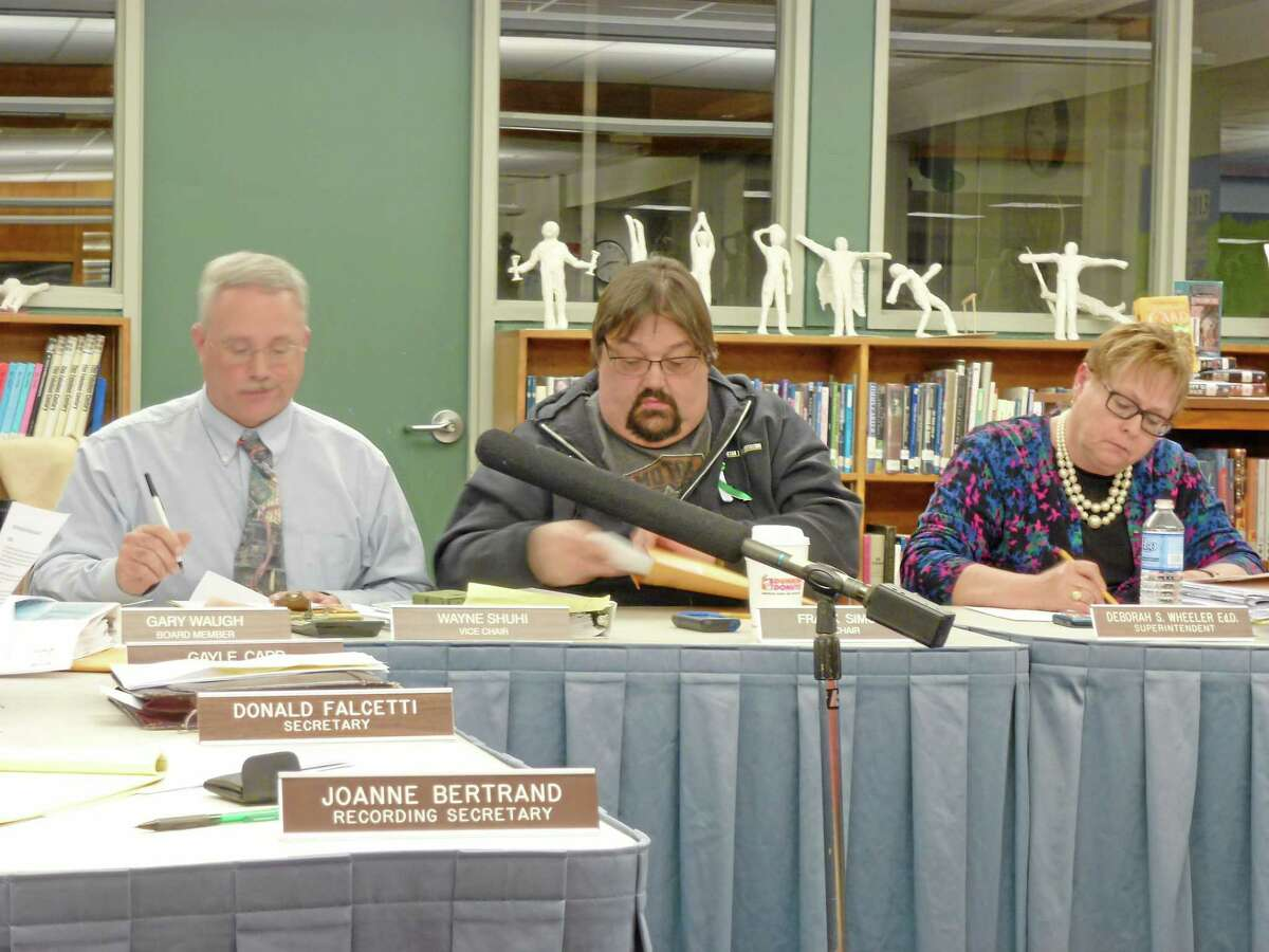 (From Left) Board of Education Vice Chair Wayne Shuhi, Chair Frank Simone and Superintendent Deborah Wheeler debate the 2013-14 proposed budget during a March 2013 meeting.