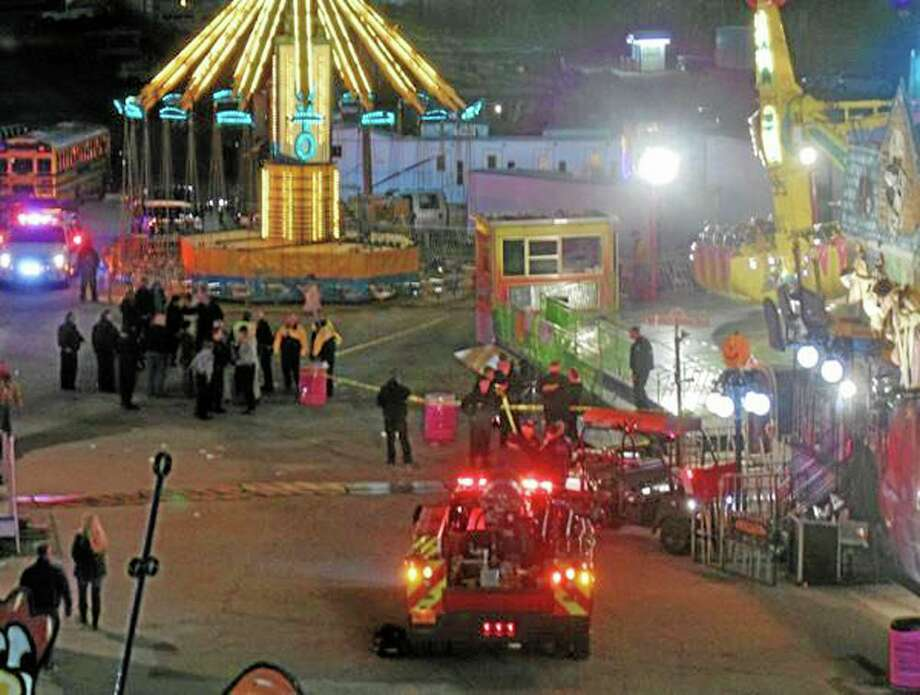 In this photo provided by WNCN, emergency crews respond to the scene where a ride malfunctioned at the North Carolina State Fair, Thursday, Oct. 24, 2013 in Raleigh, N.C. Several people were sent to the hospital with unknown injuries. (AP Photo/WNCN, Alison Blevins) MANDATORY CREDIT: WNCN Photo: AP / WNCN