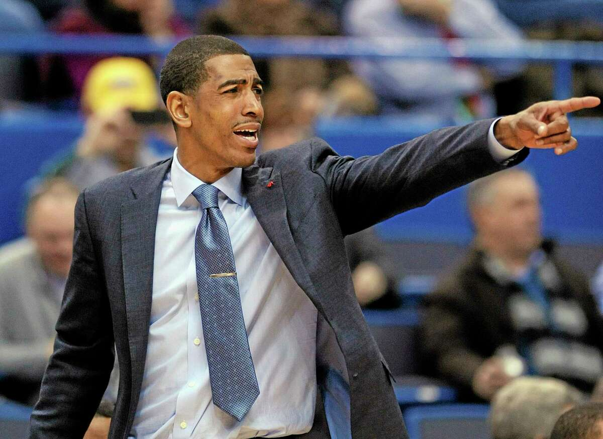 UConn head coach Kevin Ollie signals during the second half of Tuesday's 90-66 win over Temple.