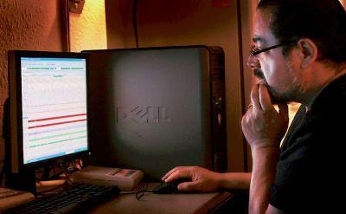 Clinic coordinator Joseph Arteaga analyzes data from a patient's sleep study.
