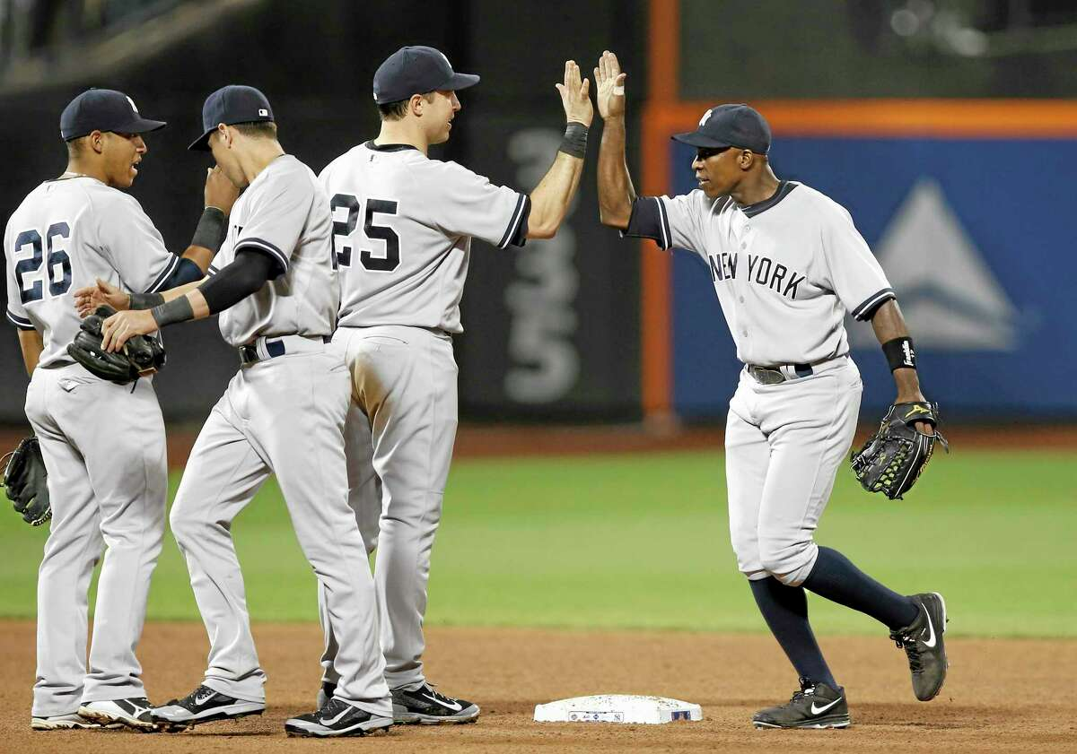 Yangervis Solarte (26), Jacoby Ellsbury and first baseman Mark Teixeira (25) celebrate with right fielder Alfonso Soriano, right, after the New York Yankees beat the New York Mets 1-0 on Thursday in Queens.