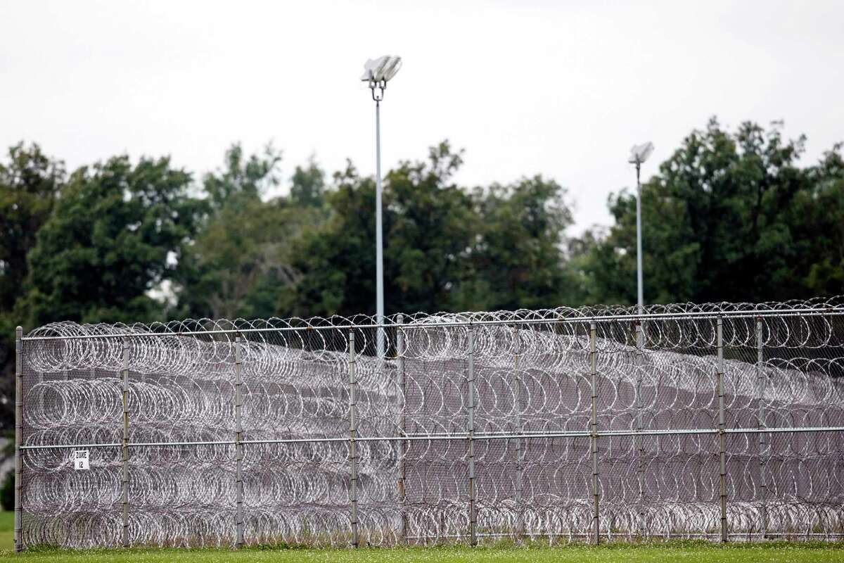 General view of the fence at the Allen Oakwood Correctional Institution Friday, Sept. 12, 2014 in Lima, Ohio. TJ Lane, a teenager convicted of killing three students at an Ohio high school, climbed over a fence Thursday Sept. 11, 2014 to escape the state prison with two other prisoners. He was caught nearly six hours later early Friday as he hid by a nearby church, in Lima, OH. (AP Photo/Rick Osentoski)
