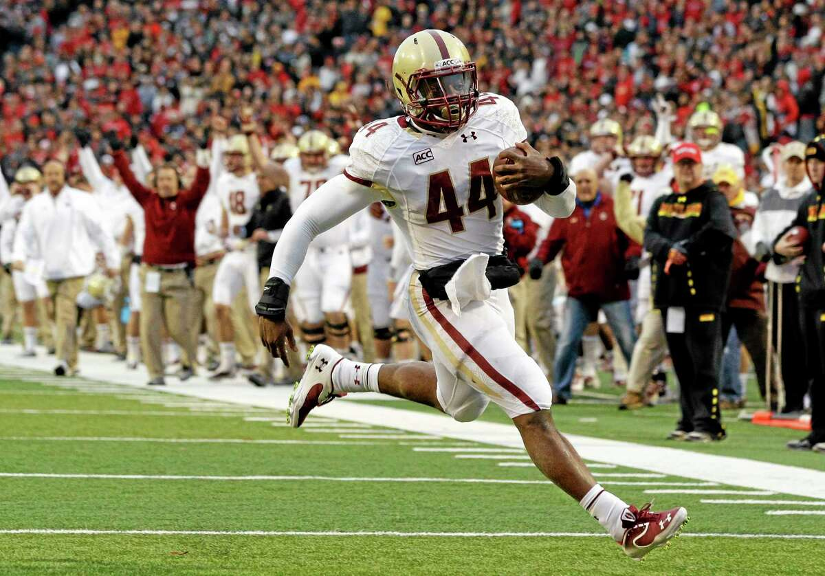 In this Nov. 23, 2013 file photo, Boston College running back Andre Williams jogs into the end zone for a touchdown against Maryland in College Park, Maryland.