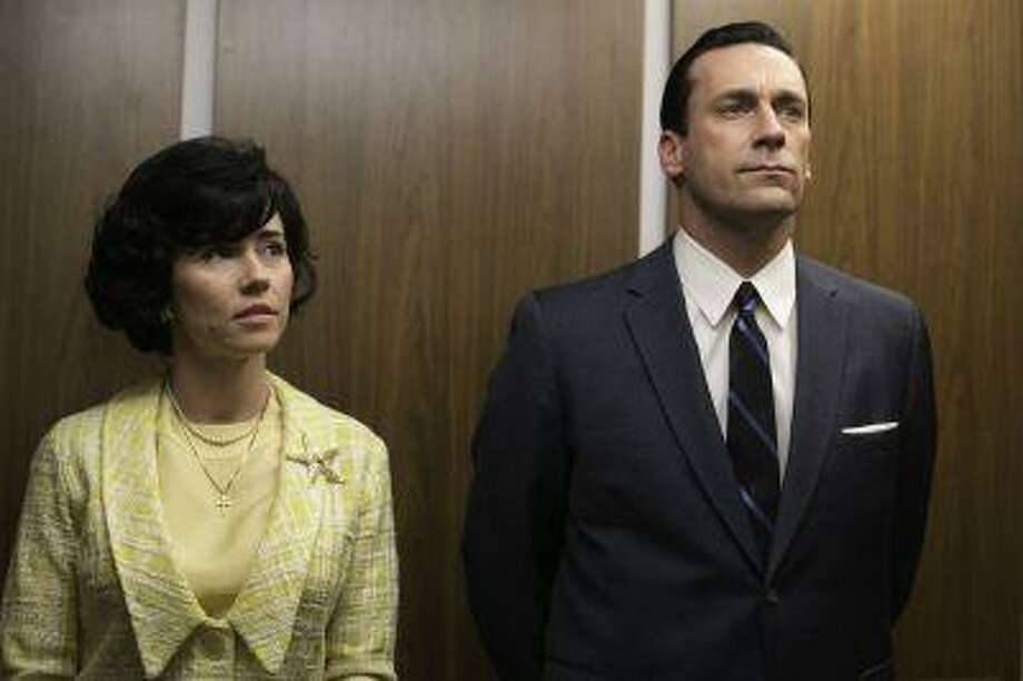 "This TV publicity image released by AMC shows Linda Cardellini as Sylvia Rosen, left, and Jon Hamm as Don Draper in a scene from ""Mad Men."" The season finale airs Sunday, June 23, on AMC. (AP Photo/AMC, Jordin Althaus) Photo: AP / AMC"