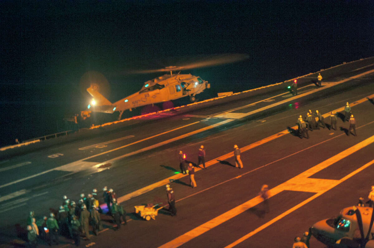 This photo provided by the US Navy, a MH-60S Sea Hawk helicopter lands on the flight deck of the Nimitz-class aircraft carrier USS Carl Vinson (CVN 70) during search and rescue operations for a missing pilot on Friday, Sept. 12, 2014. Two U.S. Navy jets crashed into the western Pacific Ocean on Friday and only one pilot was immediately rescued, military officials said. A night search for the missing pilot was underway. The F/A-18C Hornet fighter jets were from Carrier Air Wing 17 based at Naval Air Station Lemoore in California's San Joaquin Valley. (AP Photo/US Navy, MCS 2nd Class John Philip Wagner, Jr., Released)