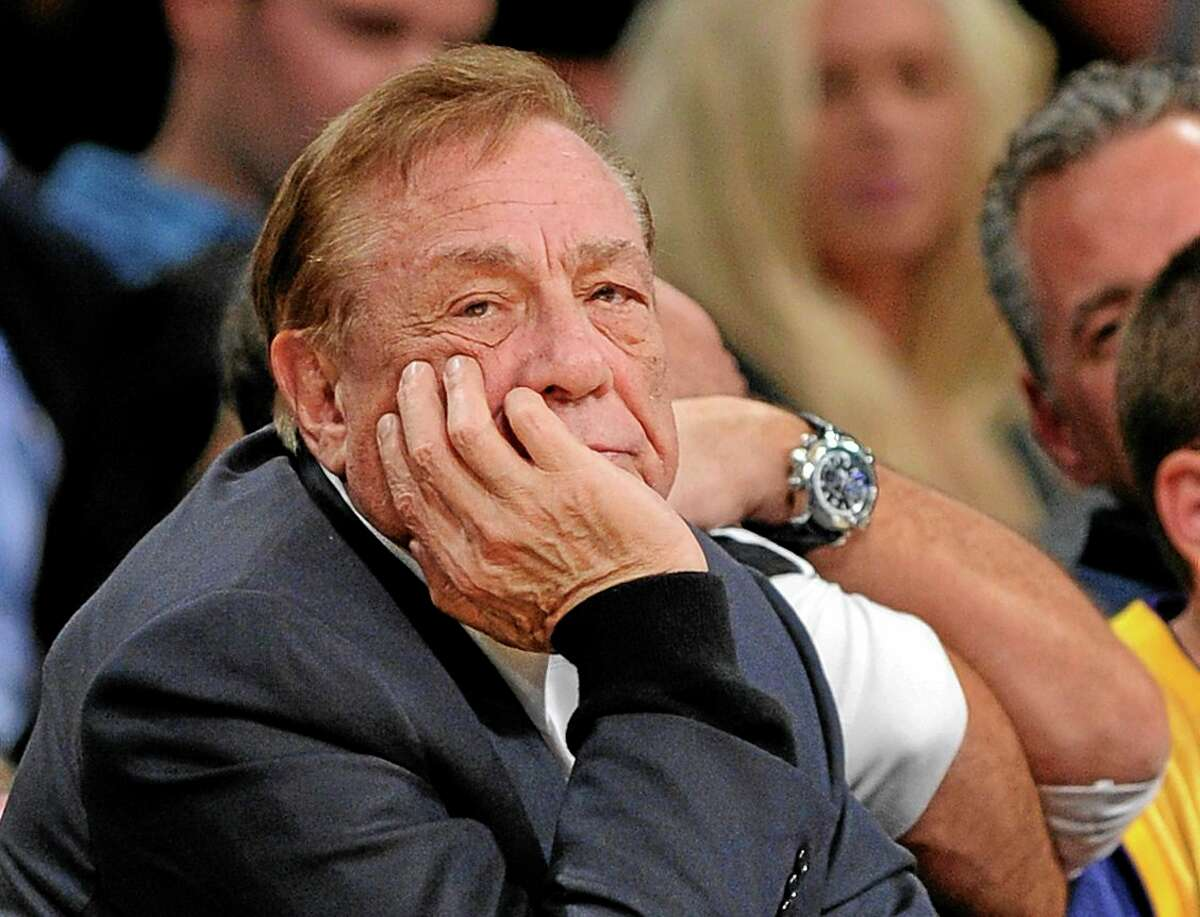 In this Feb. 25, 2011, file photo, Clippers owner Donald Sterling looks on during their game against the Lakers in Los Angeles.