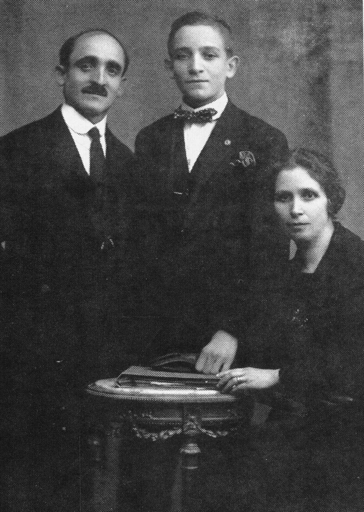 In this undated photo courtesy of Sergio Rubin, Giovanni Carlo Bergoglio, left, the grandfather of Pope Jorge Mario Bergoglio, poses with his son, Mario Jose Bergoglio, center, and his wife Margarita Vasallo in Buenos Aires, Argentina. Pope Francis will confront a piece of his own family history when he visits a WWI memorial on Saturday, Sept. 13, 2014. His grandfather, Juan Bergoglio, fought in the brutal Italian offensive against the Austro-Hungarian empire, surviving to impress upon the future pope the horrors of war. (AP Photo/Courtesy of Sergio Rubin, File)