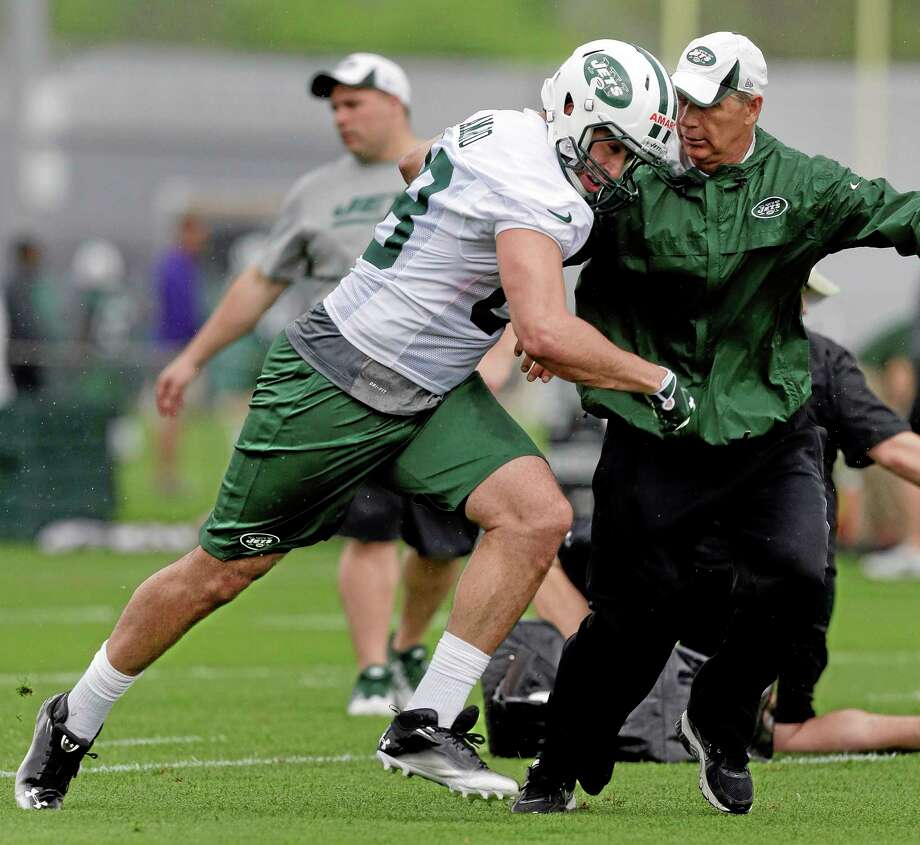 New York Jets tight end Jace Amaro, left, pushes past coach Steve Hagen during the team's rookie camp on Friday in Florham Park, New Jersey. Photo: Julie Jacobson — The Associated Press  / AP